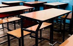 Wooden benches in a classroom Stock Photography
