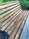 Wooden bench. Es in the corner of the park, anti-corrosion wood, and wrought iron handrails stock photo