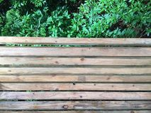Wooden bench. Es in the corner of the park, anti-corrosion wood, and wrought iron handrails royalty free stock image