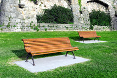 Wooden benches on garden Royalty Free Stock Photography