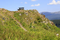 Wooden benches on mountain top Tiyahta Stock Photography