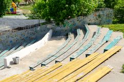 Wooden benches in outdoor theatre royalty free stock photography