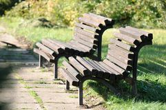 Wooden Benches in Park Stock Images
