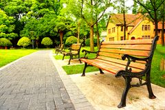 Wooden benches in the park. In the image, there are some wooden benches in the park Royalty Free Stock Photo