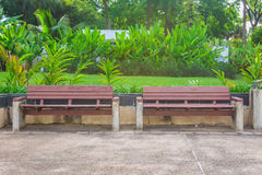 Wooden benches in park. Wooden benches in sideway at park Royalty Free Stock Images