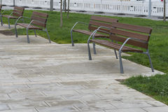 Wooden benches. Wooden benches in a public park Royalty Free Stock Photo