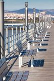 Wooden Benches Row at River Embankment Royalty Free Stock Photos