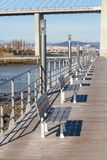 Wooden Benches Row at River Embankment. Royalty Free Stock Photo
