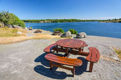 Wooden benches on sea coast Stock Photography