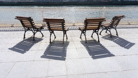Wooden benches and shadows Stock Photography
