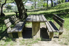 Wooden benches and a table in the woods Royalty Free Stock Photo