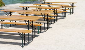 Wooden benches and tables Stock Photo