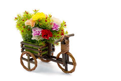Wooden bicycle with colorful carnations with clipping path Stock Image