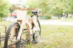 Wooden bicycle handmade from eco materials Stock Photos