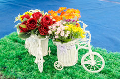 Wooden bicycle toy for decorative with artificial flowers Stock Photo