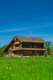 Wooden big house. Wooden large house from timbers and windows on it. It is in a village in Russia. Sunny day Royalty Free Stock Photos