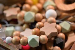 Wooden bijouterie beads close-up Stock Photos