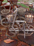 Wooden bikes decoration. Bike decoration with baskets made from raw tree branches Stock Images