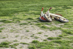 Wooden bikes in the garden. Two wooden bikes left in the grass Stock Images