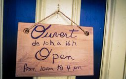 Wooden bilingual open sign Stock Images