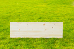 Wooden billboard on grass Royalty Free Stock Photo
