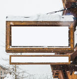 Wooden billboard with snow covered with the snow for product display montage. Royalty Free Stock Photos