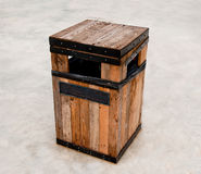 Wooden bin on floor Stock Images