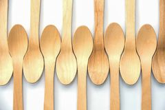 Wooden biodegradable spoons aligned on white background. Wooden biodegradable spoons, aligned on white background Royalty Free Stock Image