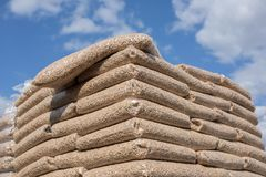 Wooden biomass in bags. Heap of bags with wooden pellet biomass royalty free stock photos