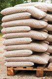 Wooden biomass in bags Royalty Free Stock Photography