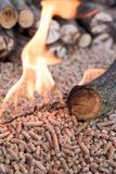 Biomass - wooden pellets in flames royalty free stock images
