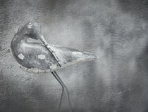 Wooden bird. Beautiful elegant image of a stylized sculpture bird with a consumed and dark wall in the background Royalty Free Stock Photography