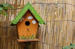 Wooden bird cage Stock Photo
