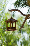 Wooden bird feeder Stock Photo