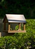 Wooden bird feeder house Stock Photography