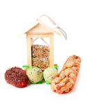 Wooden bird feeder house with food Royalty Free Stock Image