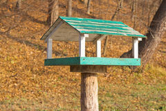 Wooden bird feeder in the park Stock Photography