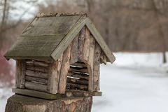 Wooden bird feeder in the form of a country house stock images