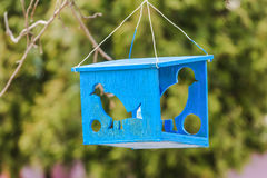 Wooden bird feeder with silhouettes of birds Stock Image