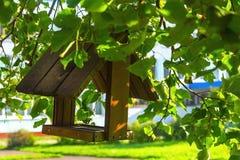 Wooden bird feeder stock photos
