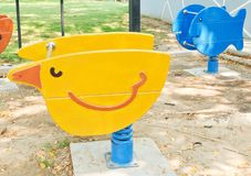 Wooden Bird and Fish Spring Seesaw in Kid Playground Royalty Free Stock Photo