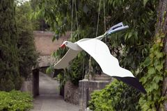 Wooden bird. Hanging wooden bird with movement in the wings when the wind blows stock photos