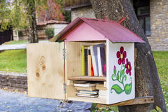 Wooden Bird house with books -reading outdoor. Decorative Bird house on a tree full of books stock photography