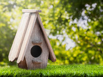 Wooden bird house on the grass Royalty Free Stock Photo