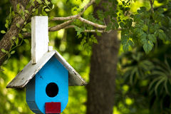 Wooden bird house. Hanging on the tree in the park stock photography