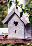 Wooden bird house. Nice wooden bird house - closeup royalty free stock photo