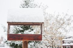 A wooden bird house in wintertime stock photo