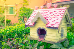 Wooden bird house in park . Royalty Free Stock Photography