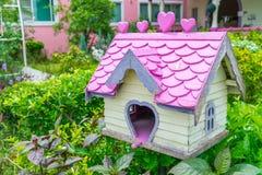Wooden bird house in park . Royalty Free Stock Photos