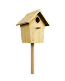 Wooden bird house on a pole  on a white background. 3d r. Endering Royalty Free Stock Photography